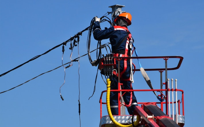 Electrician fixing power lines