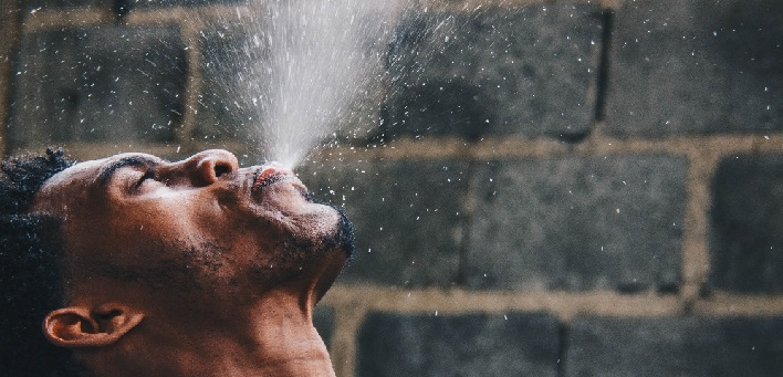 Man spraying water into the air