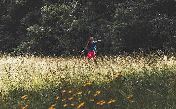 woman walking in sunny field