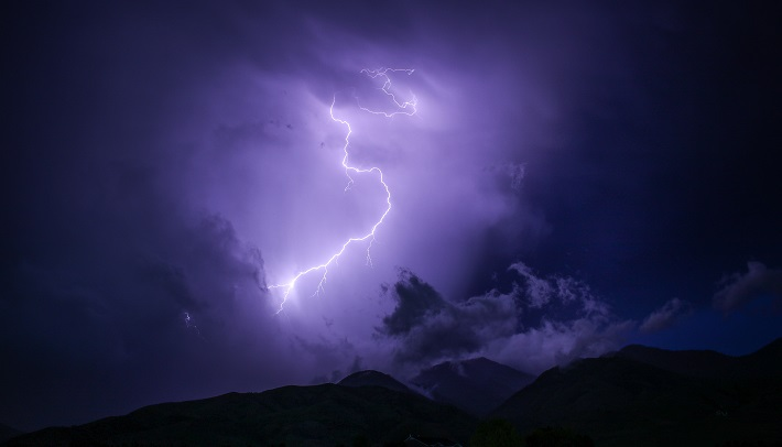 lightning strike on purple cloud background