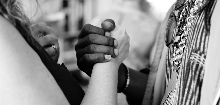 hands clasped in mutuality