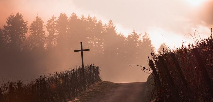 Cross alongside road on mountain pass