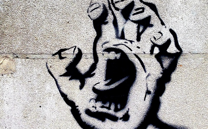 Street art of angry hand cartoon figure