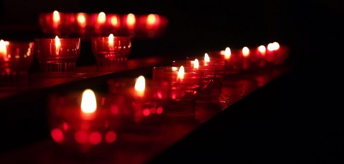 Votive candles in darkened space