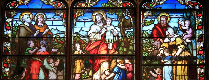 Stained-glass depiction of Jesus with children