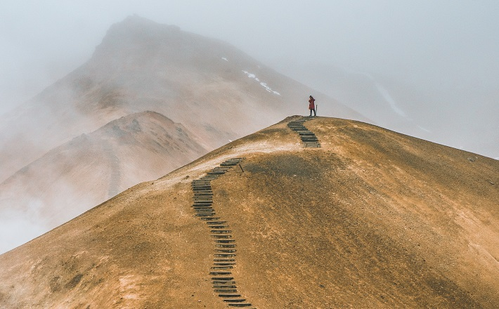 hiker on ridge with thousands of steps
